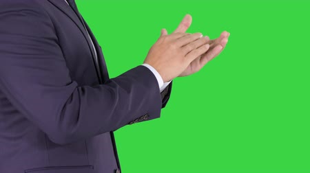 ovation : Business man clapping hands on a Green Screen, Chroma Key.