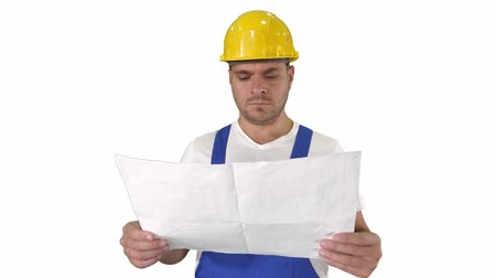 renovar : Engineer or Architect or Construction Worker holding blueprint and looking in the result of the work on white background.