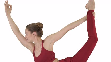 inverted : Young sporty attractive woman practicing yoga on white background. Stock Footage