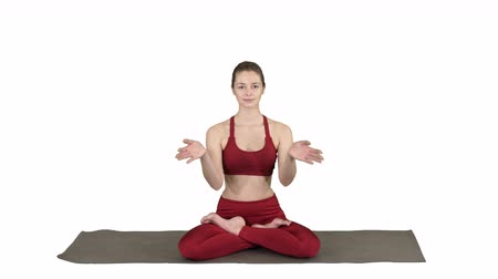 csatlakozott : Smiling woman yoga meditating sitting lotus, hands coupled on white background.