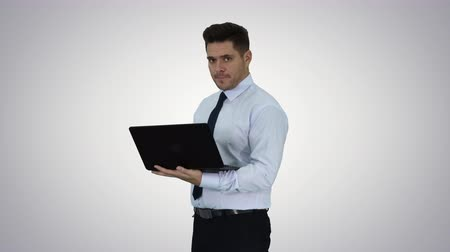 press wall : Businessman pressing play button to start or initiate projects or presentation on laptop on gradient background.