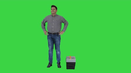 overhauls : Male contraction worker ready for work Casual man with tools walks in, looks around and making a positive gesture being ready for work on a Green Screen, Chroma Key. Stock Footage