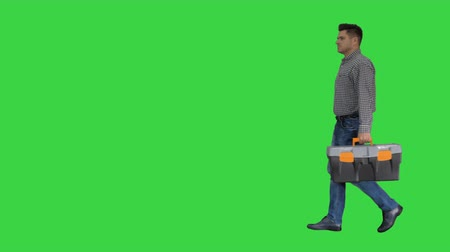 hard hat : Professional repairman concept Handyman walking with tool case on a Green Screen, Chroma Key.