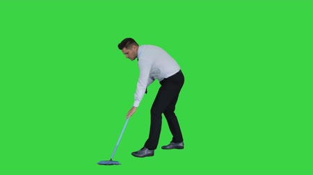 mopping : Man with thumb up holding broom in formal clothes or business outfit after sweeping floor on a Green Screen, Chroma Key.