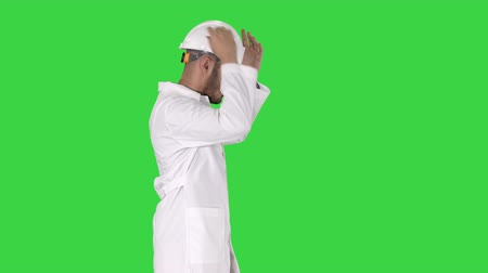 constructing : Science engineer walking and putting helmet on Safety concept on a Green Screen, Chroma Key. Stock Footage