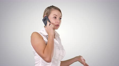 использование : Charming business woman calling with cell telephone while standing, Alpha Channel Стоковые видеозаписи