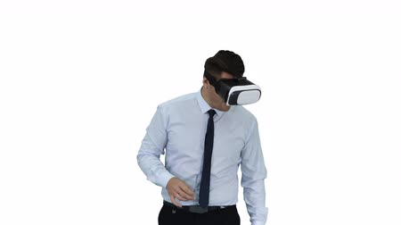 удивительный : Astonished young businessman wearing VR glasses Concept of the future technology on white background. Стоковые видеозаписи
