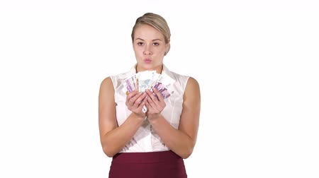 bankjegy : Happy young businesswoman holding fan of euro notes on white background.