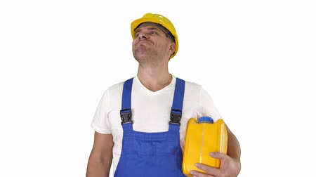 attitude : A real worker giving a thumbs up holding canister and smiling to camera on white background. Stock Footage