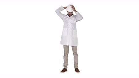 hard hat : Arab engineer in white robe putting hard hat on Safety concept on white background.
