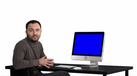 fejlövés : Handsome businessman looking in camera and talking, white background. Blue Screen Mock-up Display.