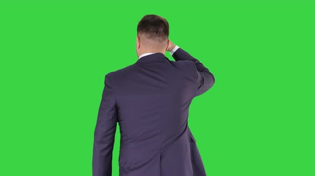 looking far away : Businessman walking and looking far away on a Green Screen, Chroma Key.