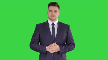 accent : Business man pointing up finger making an accent on a Green Screen, Chroma Key. Stock Footage