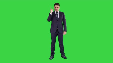 aksan : Business man pointing up finger making an accent on a Green Screen, Chroma Key. Stok Video