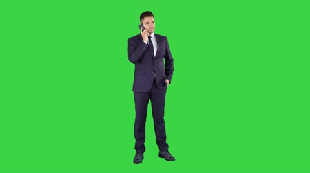 хмурый : Serious worried businessman trying to call someone and cant get through Call failed on a Green Screen, Chroma Key. Стоковые видеозаписи