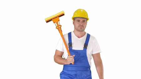 mopping : Housecleaner in helmet walking with a mop on white background.