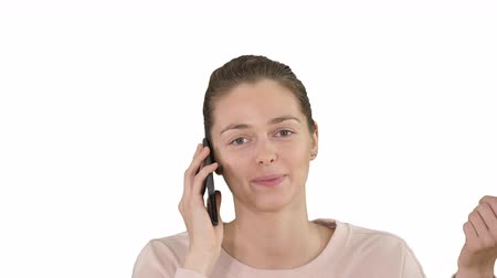 phone call screen : Smiling beautiful young woman making a call looking into camera on white background. Stock Footage