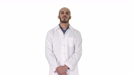 hanedan arması : Standing young serious arab doctor on white background.