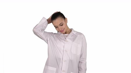 trousers : Happy young woman doctor dances on white background. Stock Footage