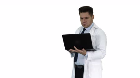 karetka : Doctor showing results in laptop on white background.