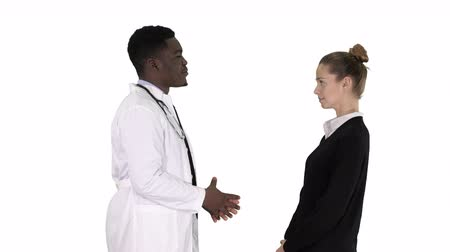 dikkatli inceleme : Doctor telling good news to a patient on white background. Stok Video