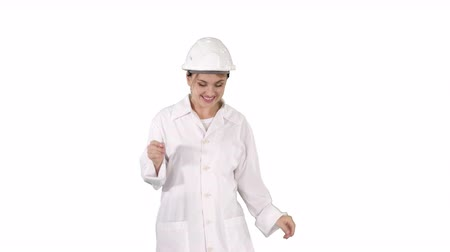 físico : Female engineer dancing on white background.