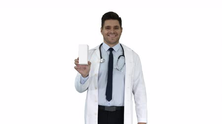 recipient : Confident Doctor Smiling and Presenting in Hand New Treatment on white background.
