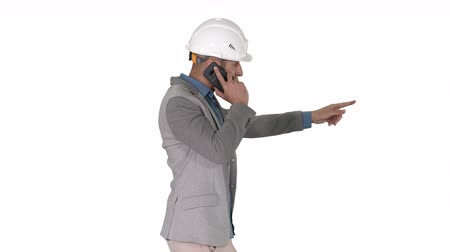 klagen : Architect engineer makes a phone call complaining about the results of work Pointing to the objects in front on white background.