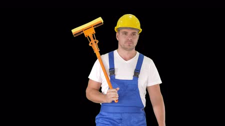 solar power : Housecleaner in helmet walking with a mop, Alpha Channel Stock Footage