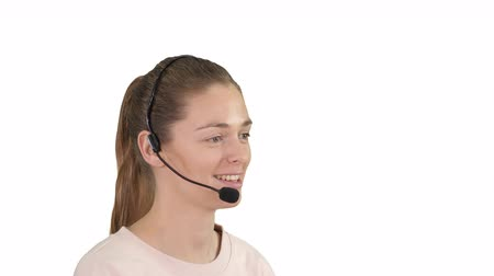 forródrót : Beautiful call center operator with headset talking on white background.