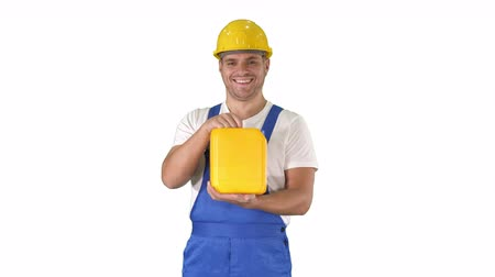 roadwork : Construction worker advertising construction material in canister on white background. Stock Footage