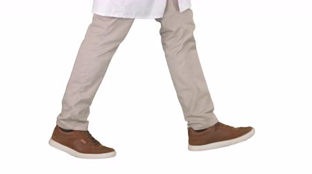 kule : Doctors legs walking on white background.