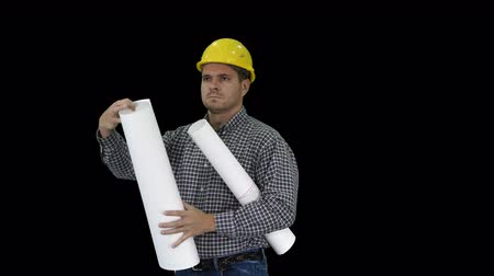 hard hat : Engineer checking plan on construction site, Alpha Channel Stock Footage