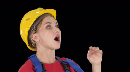 embarrassed : Engineer construction worker woman fascinated by the scale of construction, Alpha Channel Stock Footage