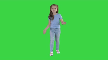 spent : Small girl walking and talking to camera making gestures on a Green Screen, Chroma Key.
