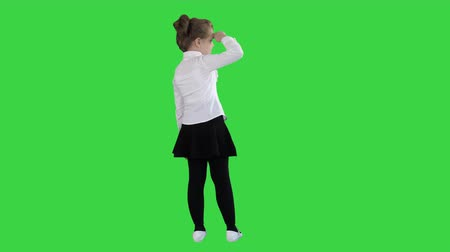 pigtail : Little girl looking away on a Green Screen, Chroma Key. Stock Footage