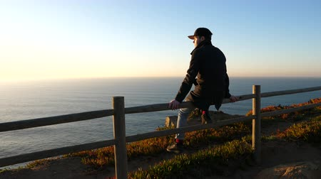 Cabo da roca. Man sitting and looking at Atlantic ocean.