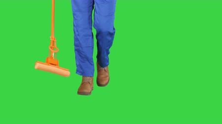 mopping : Cleaning Floor With Mop on a Green Screen, Chroma Key.