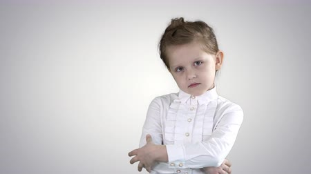 félénk : Little girl posing in different poses on gradient background. Stock mozgókép
