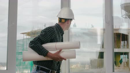 Engineer checking construction through the window.