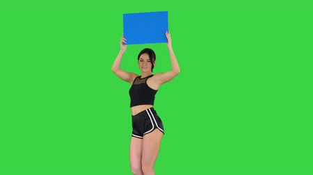 Ring girl walking holding empty board presenting new round on a Green Screen, Blue mockup.