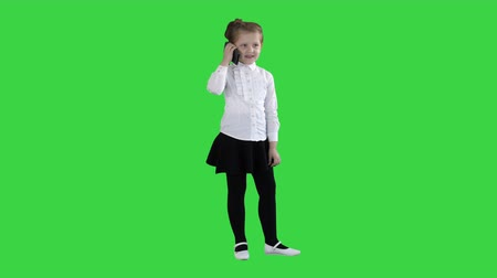 Happy girl with mobile phone Isolated on a Green Screen, Chroma Key.