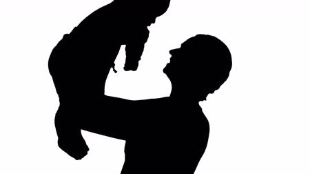 Silhouette Positive little cute boy with beautiful mom rising her baby up. 影像素材