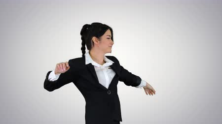 humor : Businesswoman Dancing on gradient background.
