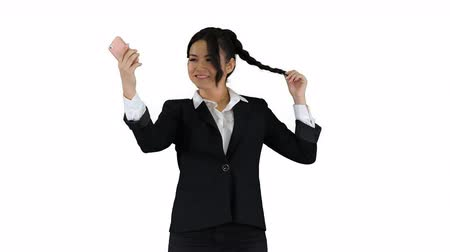 hanedan arması : Business woman look into smart phone preening and dancing on white background.