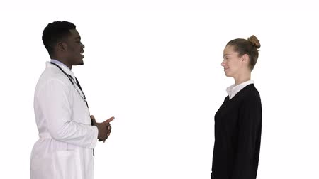 kennismaken : Acquaintance doctor with a patient on white background. Stockvideo