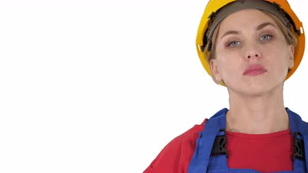 superior : Proud confident young woman worker with arms on hips on white background.
