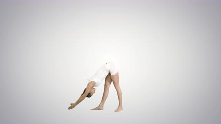 burn out : Sporty young woman practicing yoga standing in Utthita Trikonasana pose on gradient background.