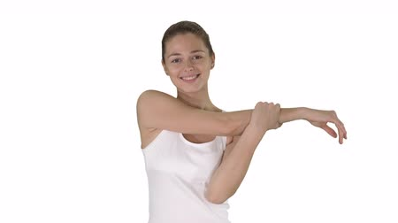 oksel : Woman happy smiling woman stretching arms while walking on white background.
