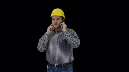 fitter : Construction worker using smartphone, Alpha Channel